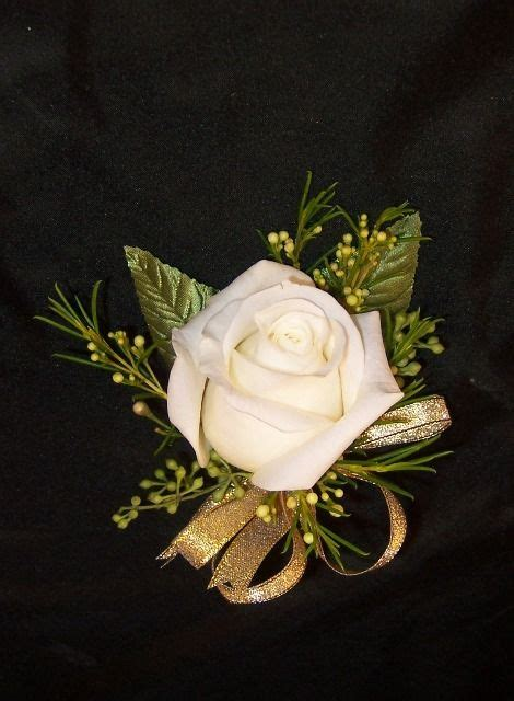 Simple white rose pin corsage with gold ribbon for a