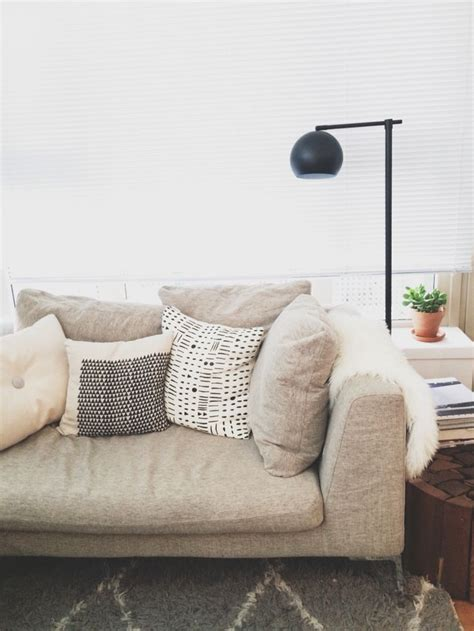 beige couch  black  white pillows sqftcom