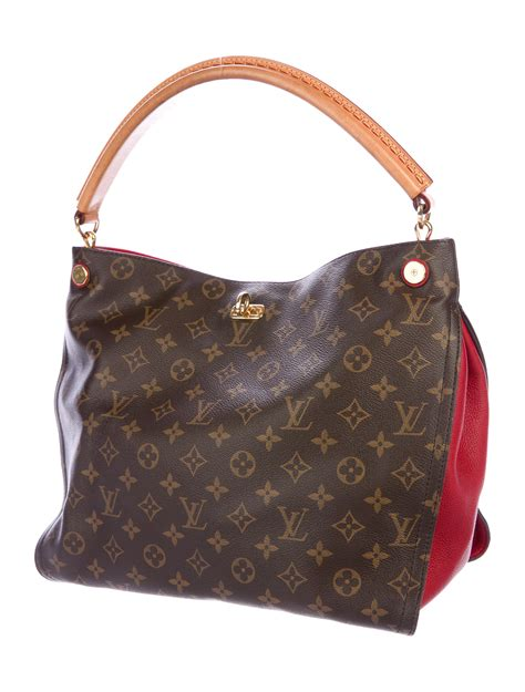 lyst louis vuitton monogram gaia bag brown  natural