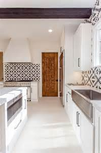 mediterranean kitchen with black and white cement tiles