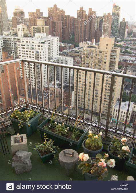 new york city residential balcony with flower garden stock