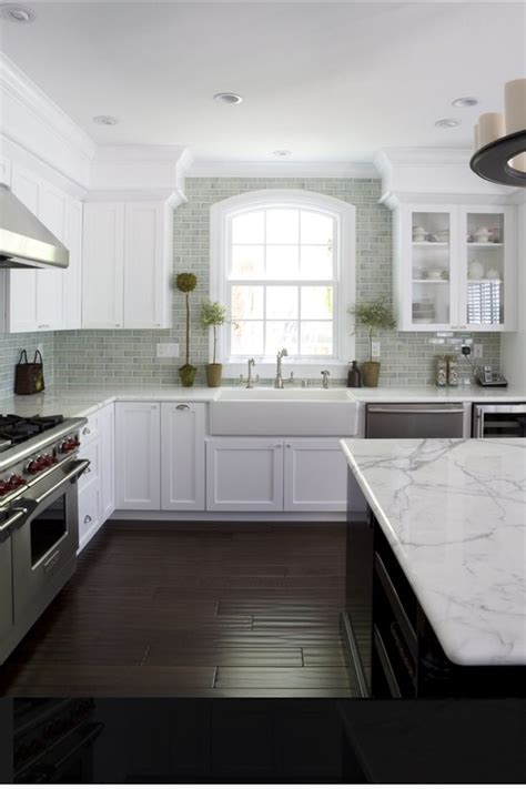 White Shaker cabinets, hand scraped wood floor, crackle