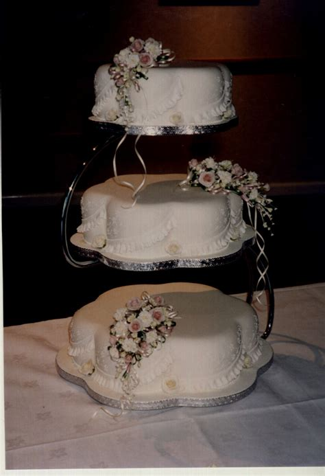 tier petal wedding cake  sugar flowers susies cakes