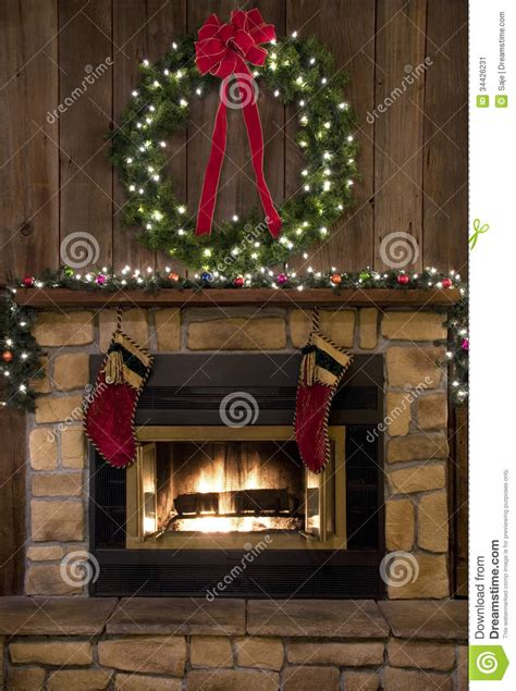 christmas fireplace hearth  wreath  stockings stock