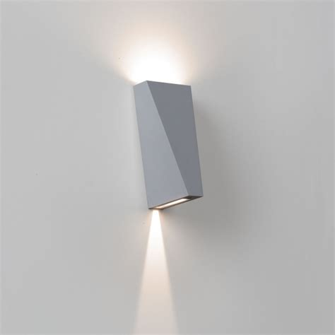 wall sconce with topix l x ww products delta light
