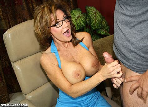 busty tutor in a blue top giving a cool titjob to her pu