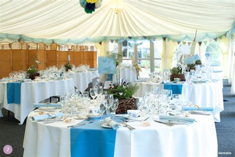 blue wedding theme ideas white linens  blue runners