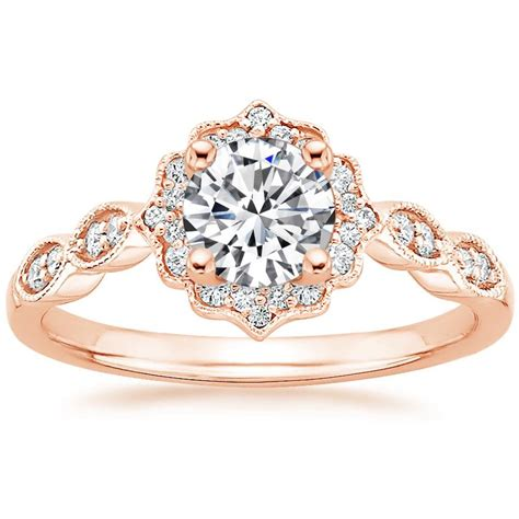 vintage inspired engagement ring cadenza halo