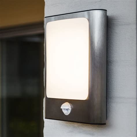 lutec face 13w pir exterior led wall light in stainless steel fitting style from dusk