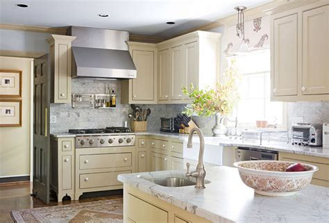 lighting kitchen cabinets pastel blues gold and greens traditional home tour 7064