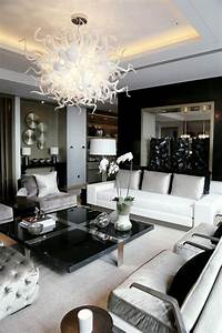 Amazing Chandelier Fixture Above Black Modern Square ...