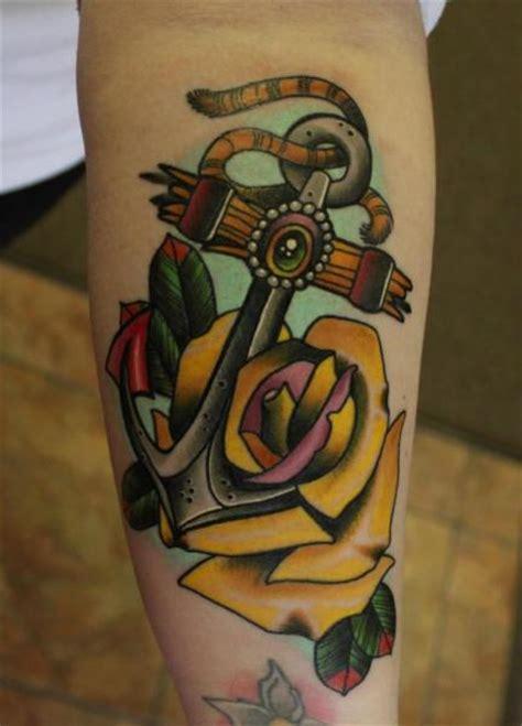arm  school blumen anker tattoo von  tattoo