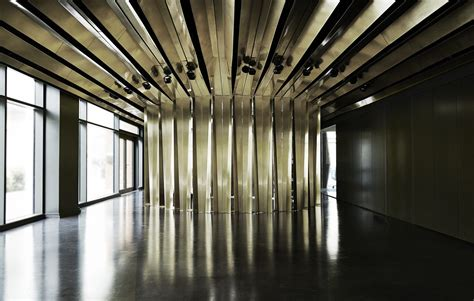 bureau de change architects architects bureau de change envelope central venue with network of brass ribbons