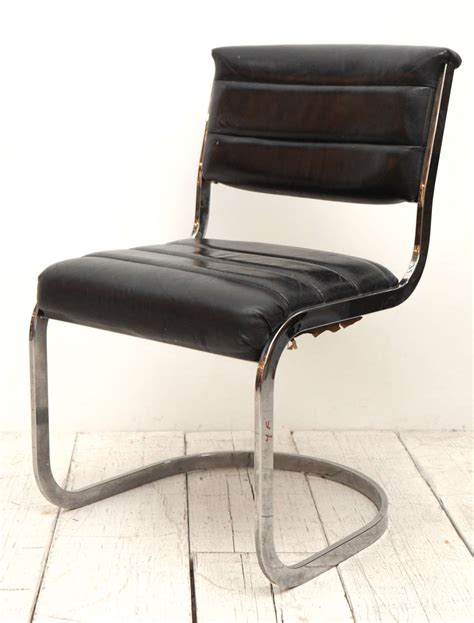 set of four ribbed black leather and chrome cantilever