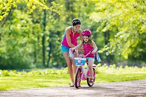 Mother Teaching Child To Ride A Bike Stock Image - Image ...