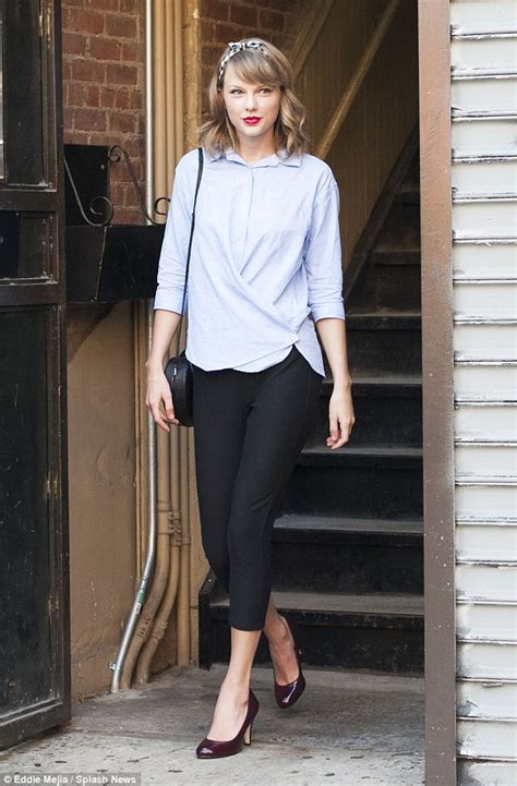 Taylor Swift Makes Exit From Fitness Class Heels