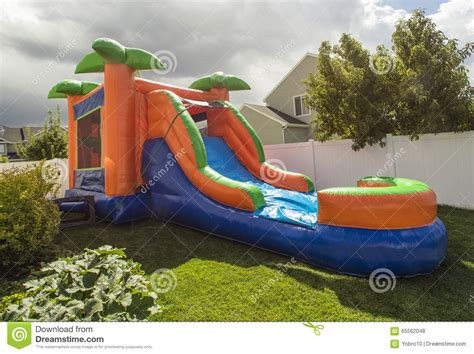 Inflatable Bounce House Water Slide In The Backyard Stock