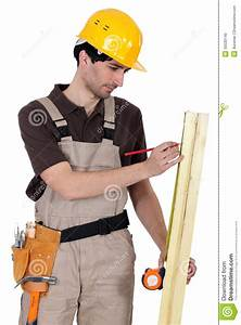Tradesman Measuring Wood Stock Photo - Image: 35530140