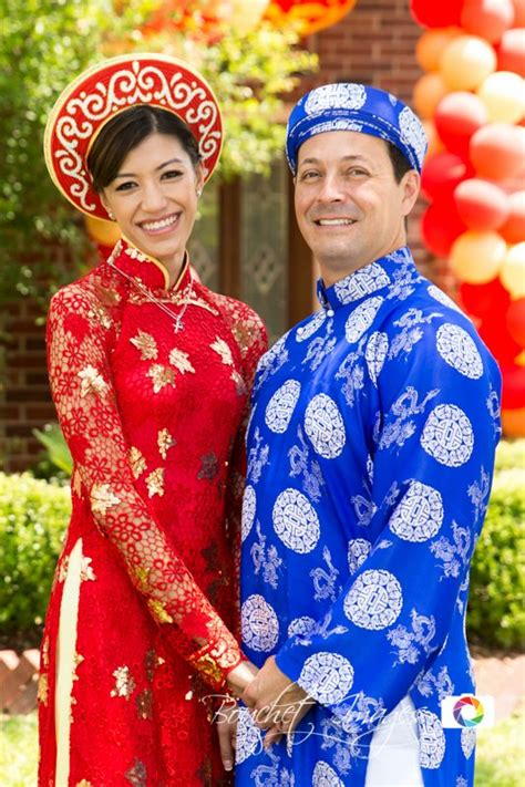 bride  groom holding hands wearing traditional
