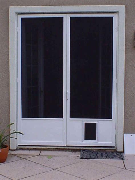 steel french doors  doggie doors dark shaded screen   storm door   doggie