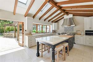 Open Vaulted Ceiling Kitchen Design With White Cabinet