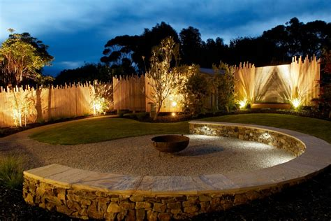 wood fence designs landscape with accent lighting