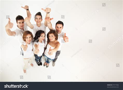 Group Of People Smiling, Approving At The Camera Stock