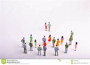A Crowd Is Looking At A Man And A Woman Who Is Walking ...