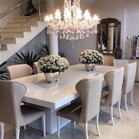 sleek white table  ivorybeige dining chairs top
