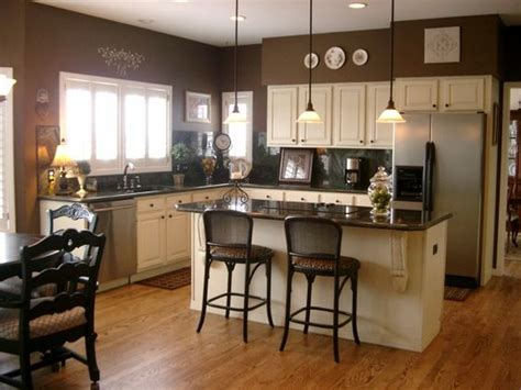 white kitchen cabinets with brown walls the walls are benjamin rockies brown the cabinets 2068