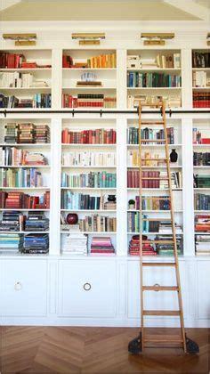 custom  minimal blackened steel bookshelves