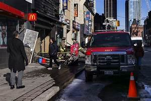 Fire crews battle three-alarm fire at Yonge and Wellesley ...