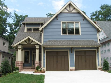 amusing house color schemes exterior brown roof wooden garage door green grass gray siding brown