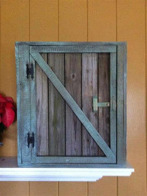 reclaimed wood barn door wall cabinet  wainscoting