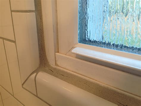 Should I use caulk to fix cracking grout in a shower