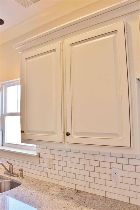painted custom cabinets white subway tile  mocha
