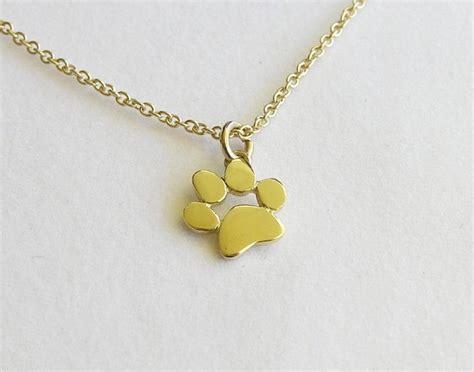 gold paw print necklace pendant solid gold jewelry