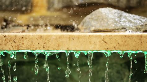 drops of water flowing from granite slabs stock