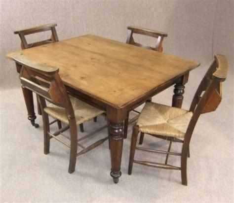 pine kitchen table and four chapel chairs
