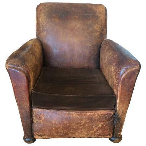 distressed leather and velvet club chair for