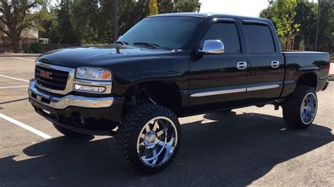 GMC Sierra lifted 6 inch Rough Country Gear 22x12 wheels