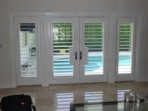 Patio Door Treatments Ideas by Plantation Shutters Traditional Entry Miami By