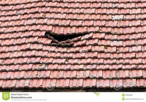 damaged tile   roof royalty  stock image