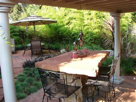 lush backyard patio with outdoor table hgtv
