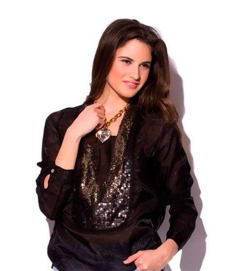 blusa de seda negra transparente con lentejuelas doradas de q2