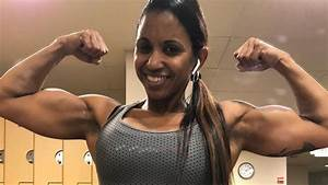 41 Years Young Muscle Woman Aymara Flexing Her Biceps