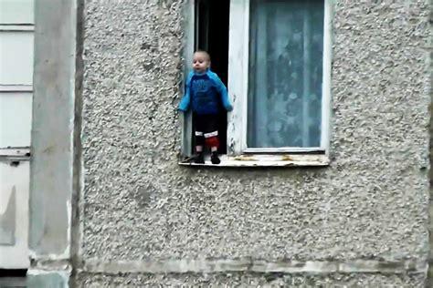 Window Ledge by Toddler Balances On Window Ledge Russia