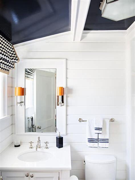 white kid bathroom  navy blue glossy ceiling
