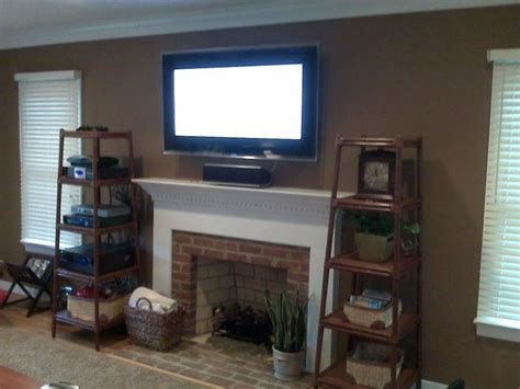 tv above fireplace where to put cable box and