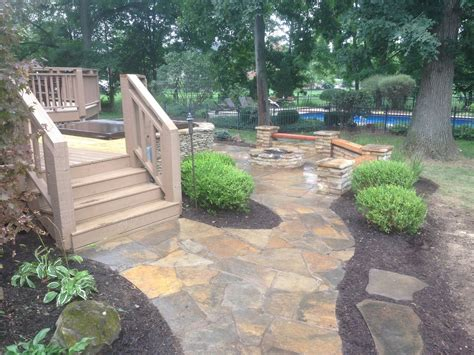 patio landscape design flagstone patio with built in hot tub creative outdoor living fishers indiana landscaping